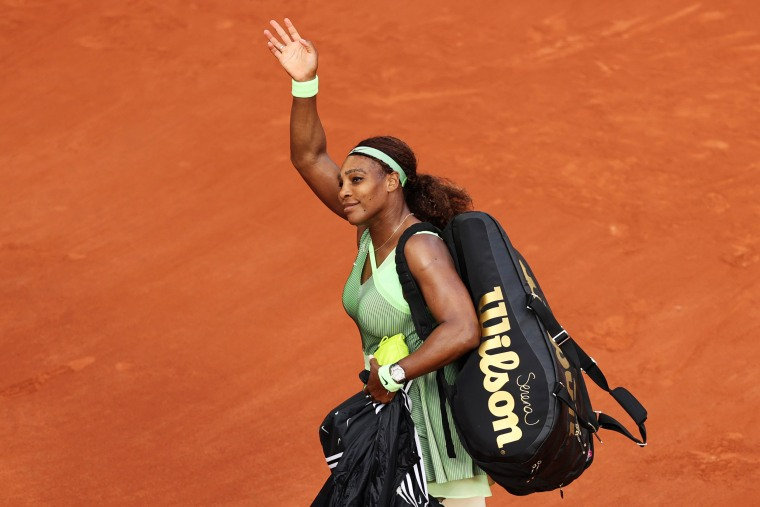 Serena Williams waves to the crowd after losing her Women's Singles fourth round match against Elena Rybakina of Kazakhstan at the French Open in Paris on June 6, 2021.