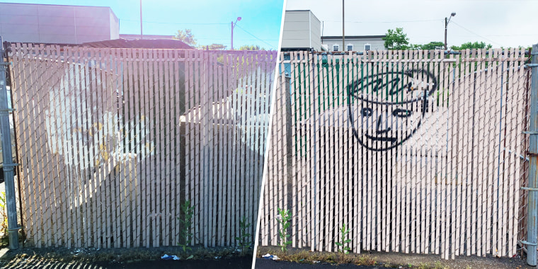 Fence with graffiti on it