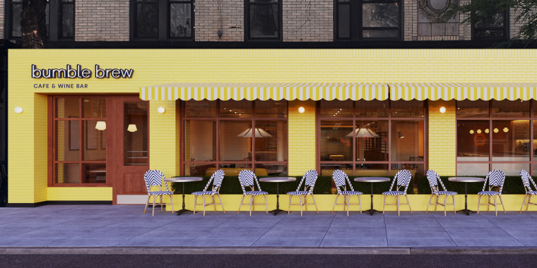 Outdoor shot of a yellow restaurant that reads Bumble Brew