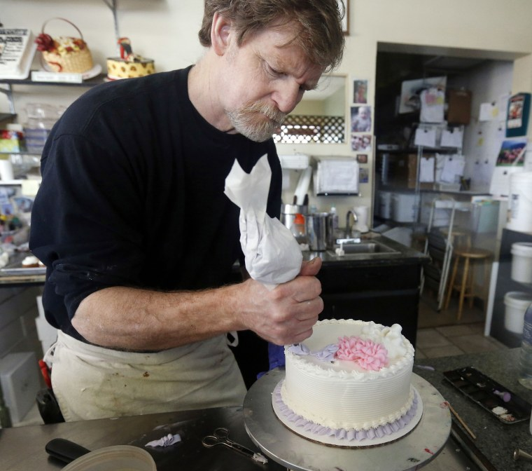 Image: Masterpiece Cakeshop owner Jack Phillips decorates a cake inside his store in Lakewood, Colo., on March 10, 2014.