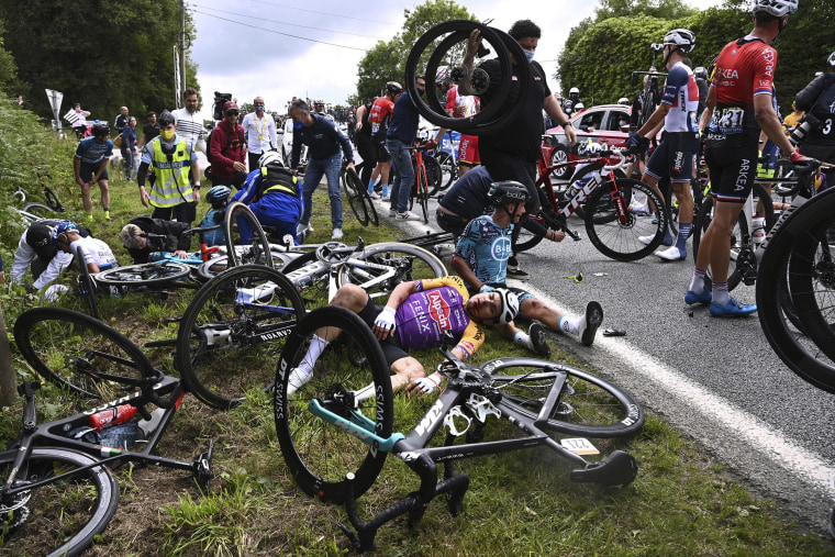 Image: Italy's Kristian Sbaragli, left, and France's Bryan Coquard, right, lie on the ground after crashing during the first stage of the Tour de France cycling race over 197.8 kilometers (122.9 miles) with start in Brest and finish in Landerneau, France