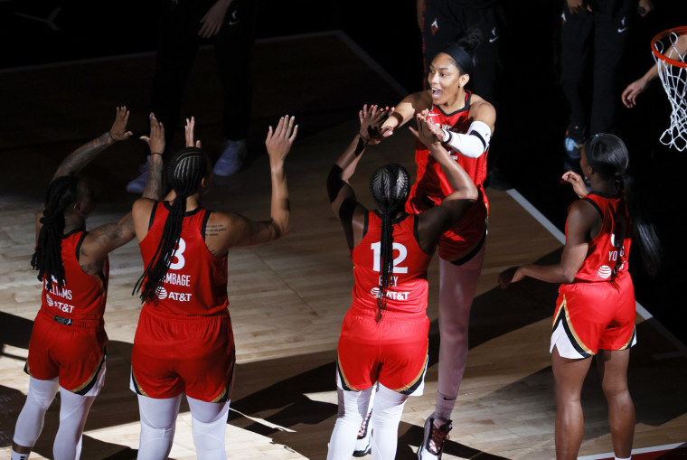 A'ja Wilson #22 of the Las Vegas Aces is greeted on the court by her teammates before their game against the Seattle Storm on June 27, 2021, in Las Vegas.