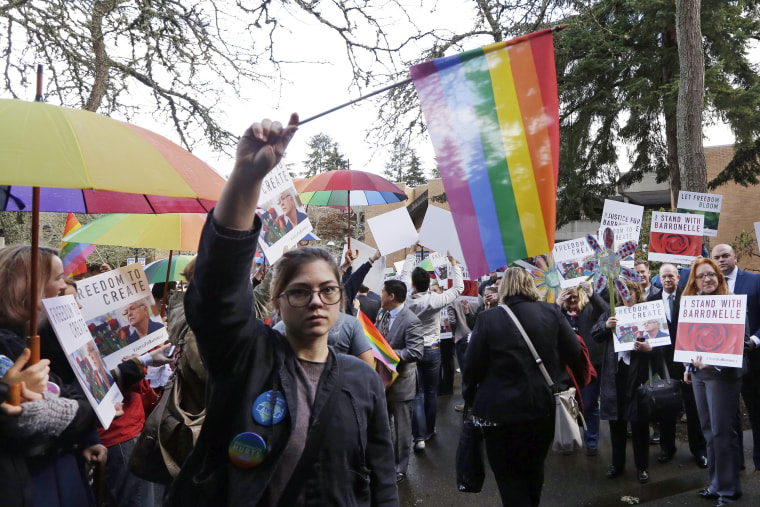 Image: Supporters on both sides of the case line a walkway following a hearing before Washington's Supreme Court about a florist, Barronelle Stutzman, who was sued for refusing to provide services for a same sex-wedding on Nov. 15, 2016, in Bellevue, Wash