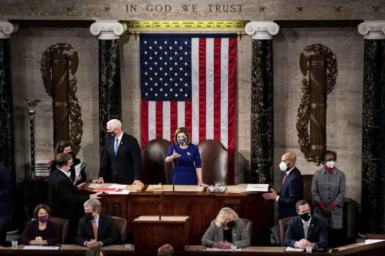 Image: House Speaker Nancy Pelosi and Vice President Mike Pence officiate as a joint session of the House and Senate convenes to confirm the Electoral College votes cast in November's election, at the Capitol on Jan. 6, 2021.