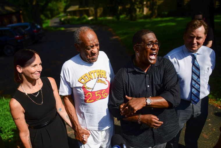 Image: Bill Cosby stands next to his spokesman Andrew Wyatt outside Cosby's home after Pennsylvania's highest court overturned his sexual assault conviction and ordered him released from prison immediately, in Elkins Park
