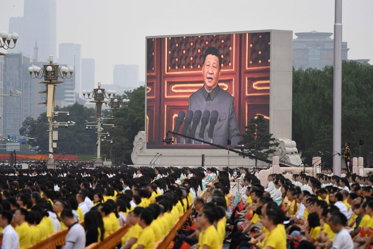 Image: Chinese President Xi Jinping delivers a speech during the celebrations of the 100th anniversary of the founding of the Communist Party of China at Tiananmen Square in Beijing