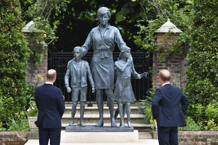 Prince William, left, and Prince Harry unveil a statue they commissioned of their mother Princess Diana, on what would have been her 60th birthday, in the Sunken Garden at Kensington Palace, London, on July 1, 2021.
