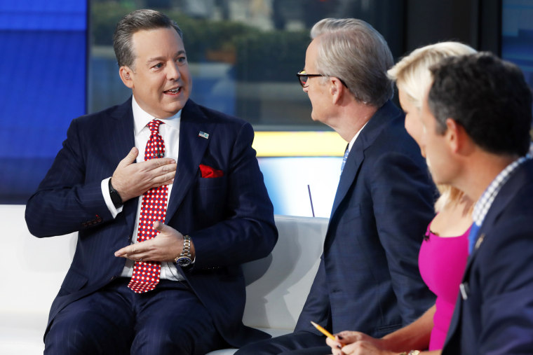"""Fox News Chief National Correspondent Ed Henry, left, appears on \""""Fox and Friends\"""" in New York on Sept. 6, 2019."""