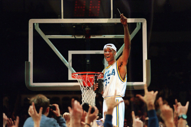 Image: Ed O'Bannon cuts the net after UCLA defeated UConn in the West Regional Final in Oakland, Calif., on March 25, 1995.
