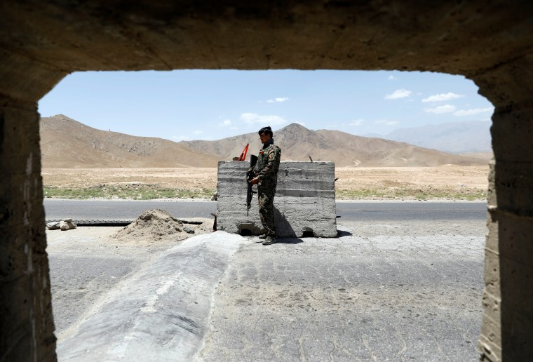 Image: Afghan National Army soldier stands guard at a check post near Bagram U.S. air base