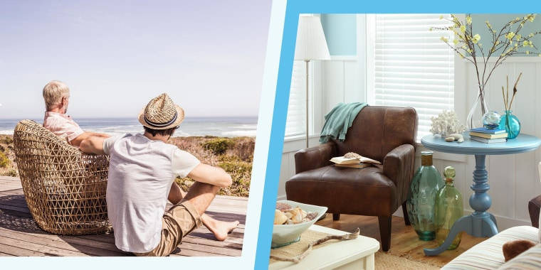 Father and adult son sitting on a terrace at the sea and a Beach House living room
