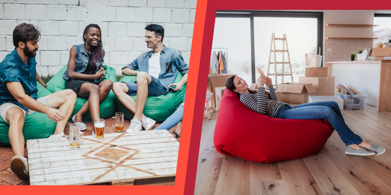 Group of people drinking beer, relaxing in the bean bags and Woman with smartphone sitting on bean bag among moving boxes