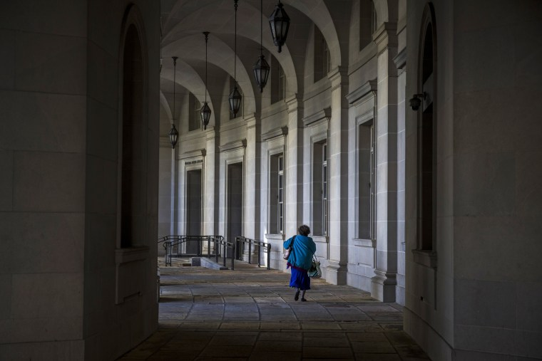A person walks past the Internal Revenue Service building in Washington, DC.