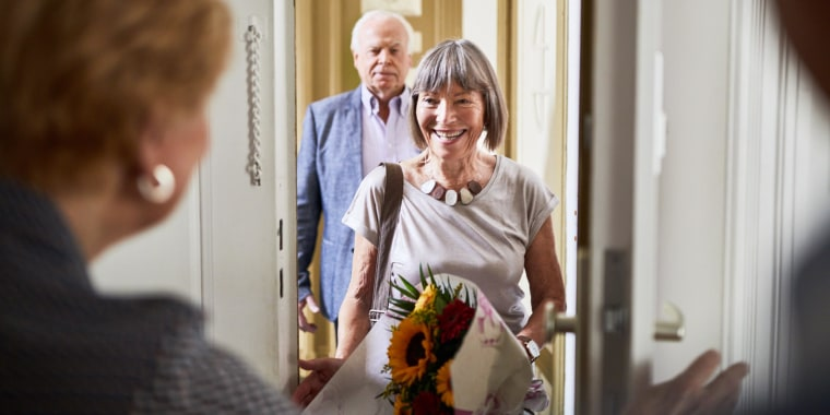 Senior woman meeting smiling couple with flowers at the door. Shop the 18 best housewarming gift ideas of 2021. From smart lights to bathtub caddies, these unique home gifts make perfect housewarming presents.