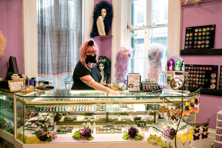 Image: An employee at Fifi Mahoney's, a French Quarter salon and wig shop, disinfects surfaces in New Orleans, on May 16, 2020.