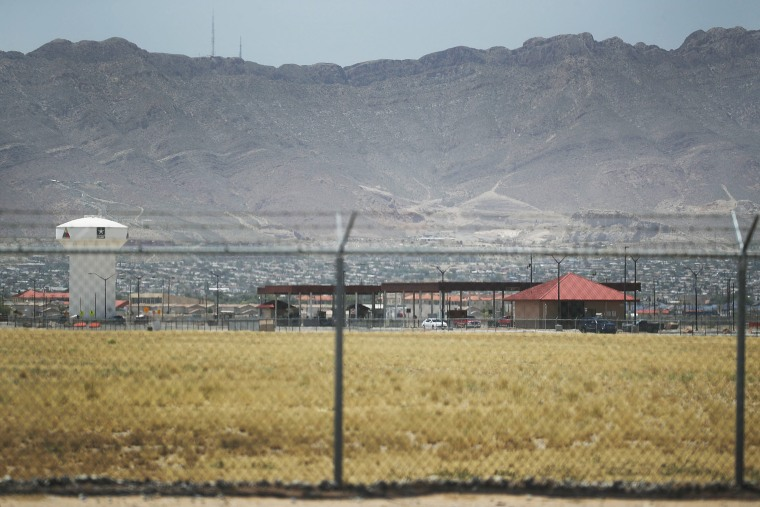 Fort Bliss, which holds temporary housing for migrants is seen through a fence on June 25, 2018 in Fort Bliss, Texas.