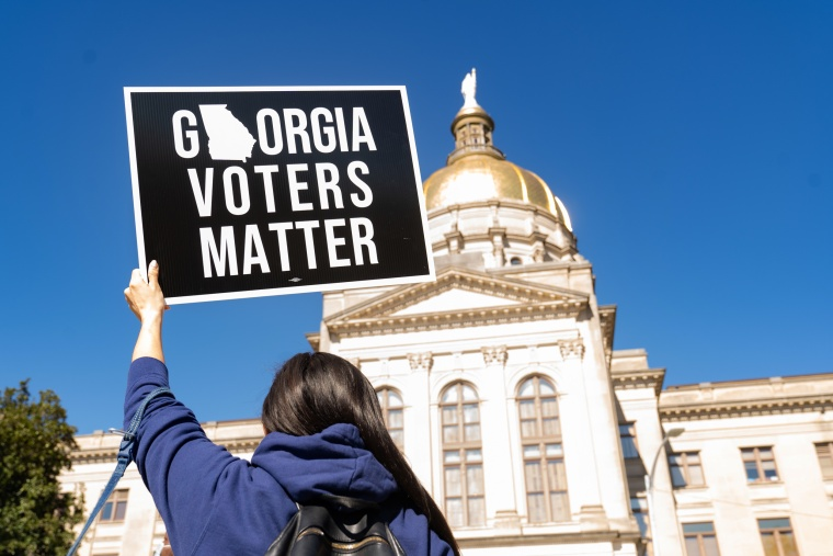 Demonstrators stand outside of the Capitol building in Atlanta on March 3, 2021, to oppose the HB 531 bill that would place restrictions on voting.