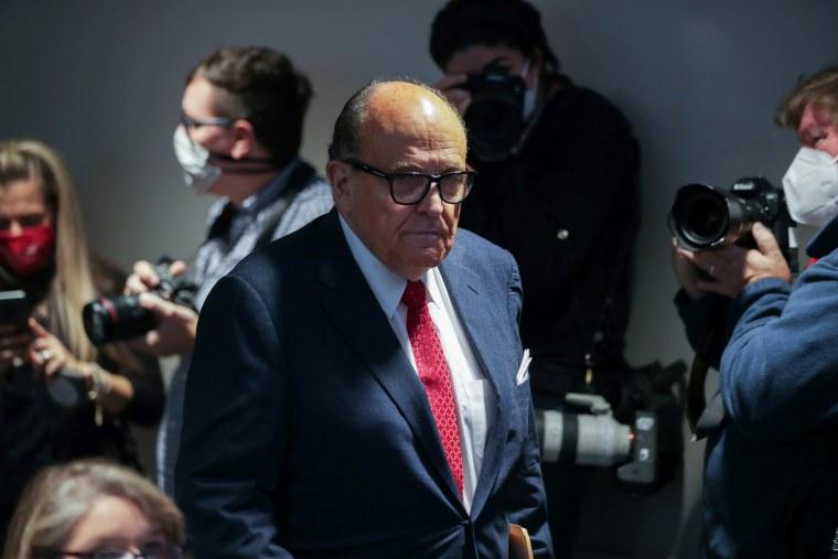 Rudy Giuliani arrives to speak in Washington on Nov. 19, 2020.