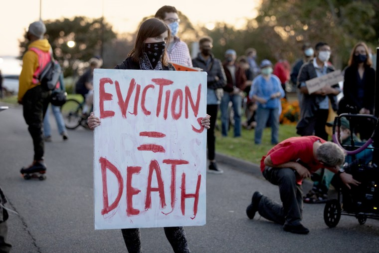 Housing activists gather in front of Gov. Charlie Baker's house on Oct. 14, 2020, in Swampscott, Mass.
