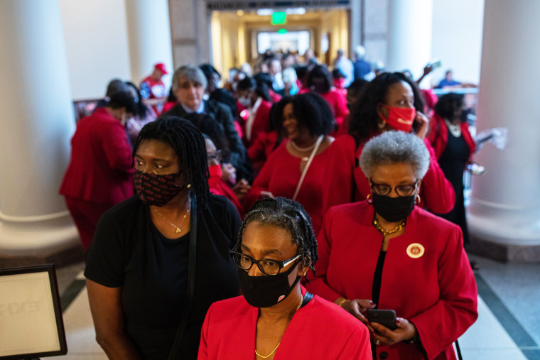 People stand in line to testify before the House Select Committee on Constitutional Rights and Remedies at the Capitol on July 10, 2021, in Austin, Texas.