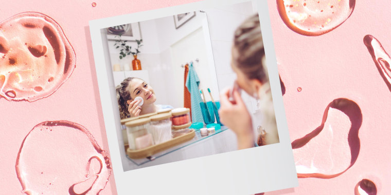 Background of Drops and smears of assorted cosmetic products and a Woman putting on Face Toner while looking in the mirror