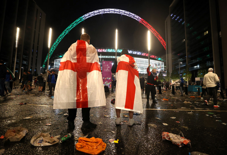 Image: England fans outside Wembley Stadium after Italy's win