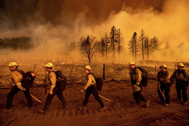 Firefighters battle the Sugar Fire in Doyle, Calif