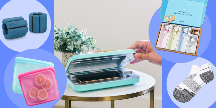 Illustration of someone using the PhoneSoap 3, Two Stasher bags, Blueland clean essentials, white Bombas socks and Bala Bangle weights