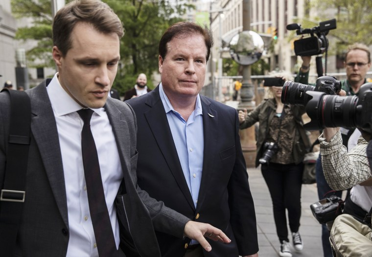 Image: Stephen Calk, founder of the Federal Savings Bank of Chicago, center, exits federal court in New York, on May 23, 2019.