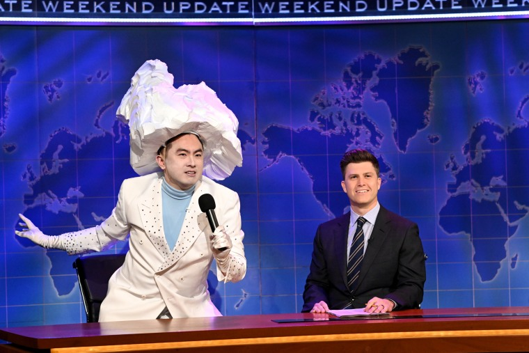 Bowen Yang as 'The Iceberg That Sank The Titanic' and anchor Colin Jost during Weekend Update on April 10, 2021.