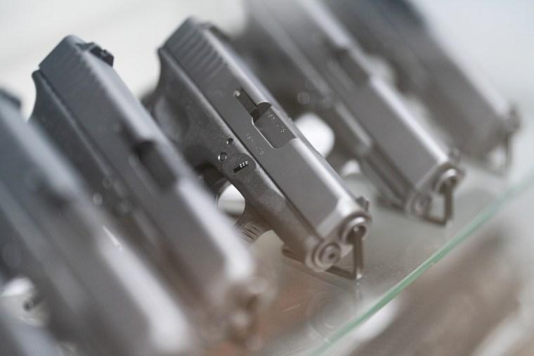 Glock semi-automatic pistols are displayed at Hiram's Guns/Firearms Unknown store in El Cajon, Calif., on April 26, 2021.