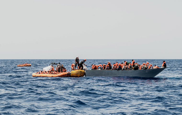 Image: Migrants are rescued during a search and rescue operation in the Mediterranean Sea
