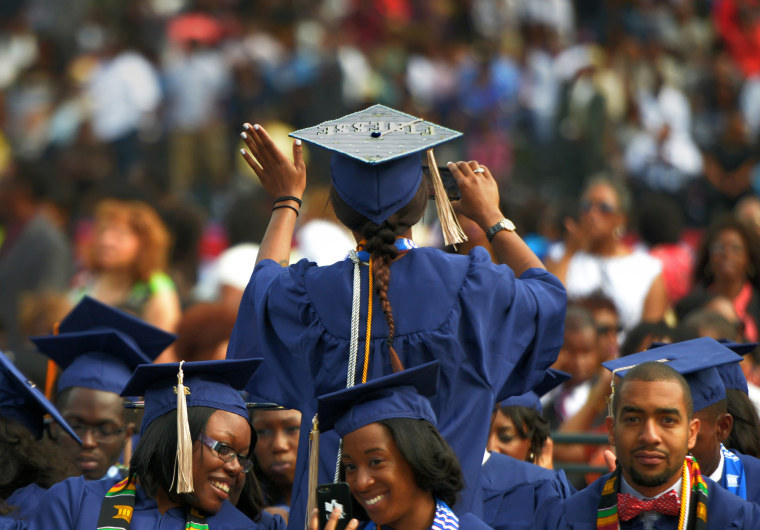 Image: A student waves to family members as she takes her seat for Howard University's commencement in Washington on May, 10, 2014.