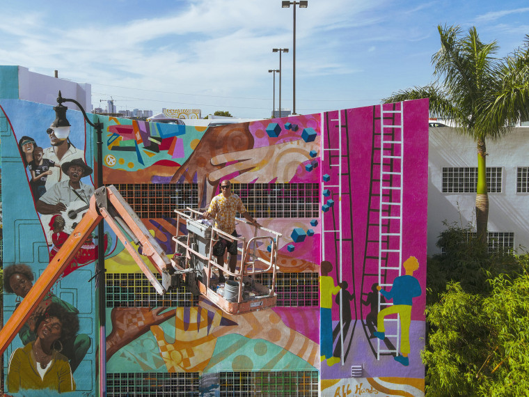 Image: Muralist Kyle Holbrook paints a mural in honor of the victims of the Champlain Tower building collapse on July 14, 2021 in Miami.