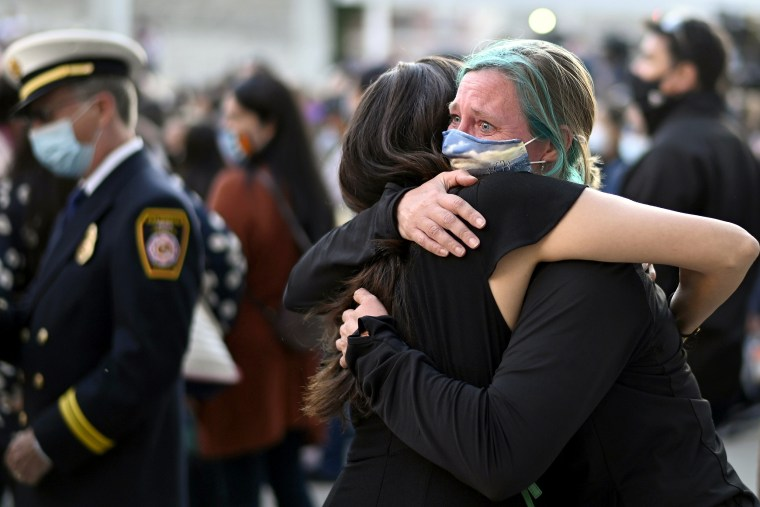 Image: Stephanie Jayne, right, hugs a friend at a vigil at City Hall in San Jose, Calif., on May 27, 2021, in honor of the multiple people killed when a gunman opened fire at a rail yard the day before.