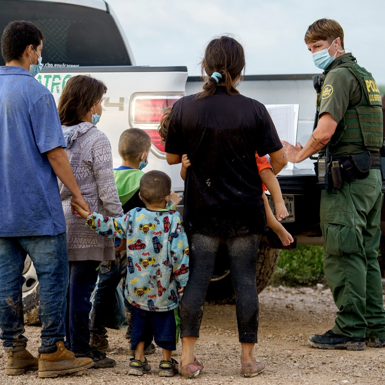 Image: Migrants are processed by the United States Border Patrol after crossing the U.S.-Mexico border into the United States in Penitas, Texas on July 8, 2021.