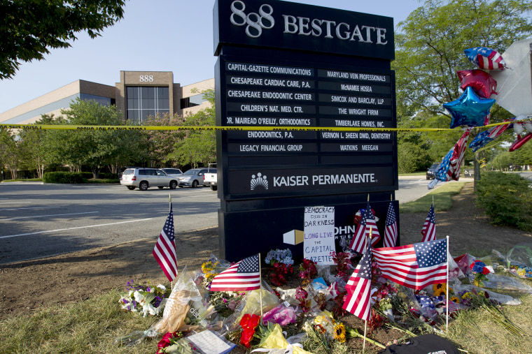 A makeshift memorial at the scene outside the office building housing The Capital Gazette newspaper in Annapolis, Md., on July 1, 2018.