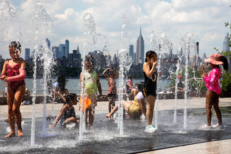 Children cool off in a fountain in Brooklyn, N.Y., on June 29, 2021.