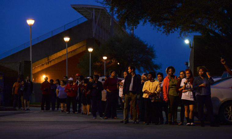 Image: Voters wait in line to cast their ballot.