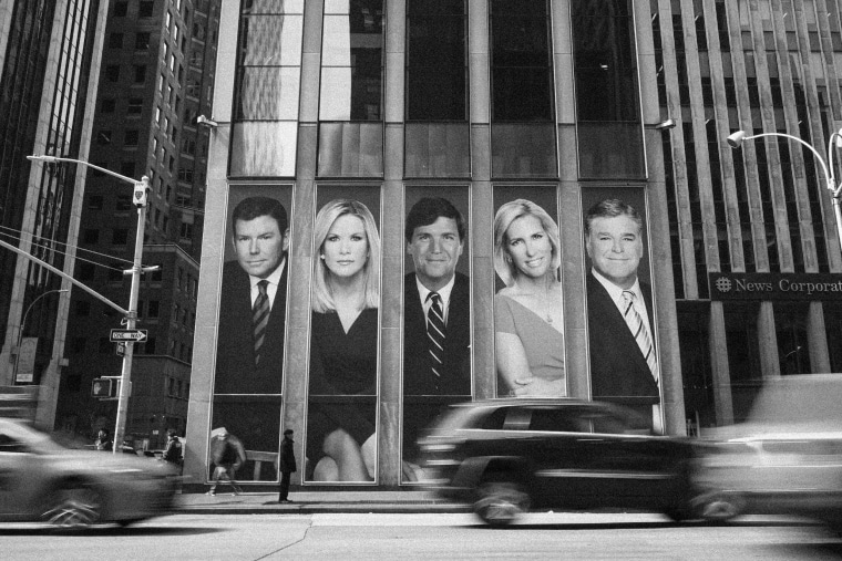 Fox News personalities, including Bret Baier, Martha MacCallum, Tucker Carlson, Laura Ingraham, and Sean Hannity, adorn the front of the News Corporation building on March 13, 2019, in New York.