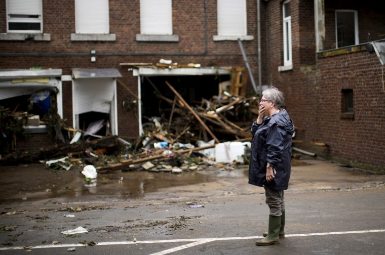 Image: A woman reacts as she stands in front of her damaged house after flooding in Ensival, Verviers, Belgium on July 16, 2021.