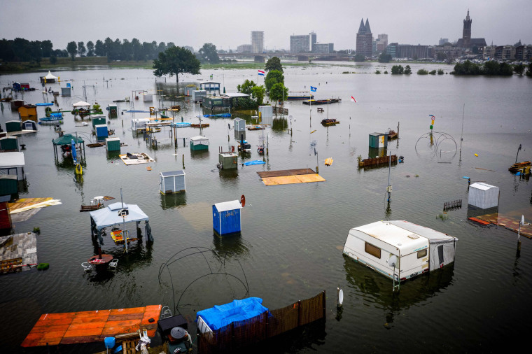 Partially submerged caravans and campers at the camping site of De Hatenboer in Roermond on July 15, 2021.