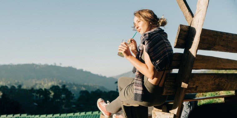 Woman drinking iced tea on the bench