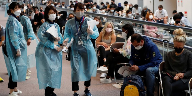 Image: Officials prepare to administer COVID-19 antigen test to U.S. gymnastics team at Narita Airport ahead of Tokyo 2020 Olympic Games, in Narita
