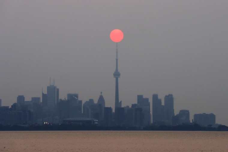 Hazy Sunrise Above the CN Tower in Toronto, Canada