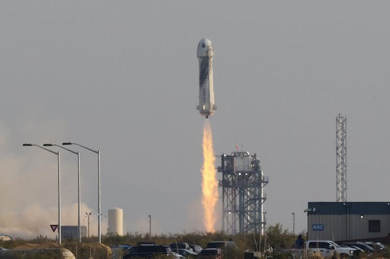 Image: Billionaire businessman Jeff Bezos is launched with three crew members aboard Blue Origin's New Shepard rocket