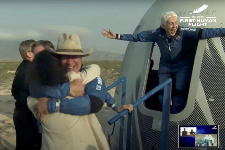 Image: Billionaire businessman Jeff Bezos and pioneering female aviator Wally Funk emerge from their capsule