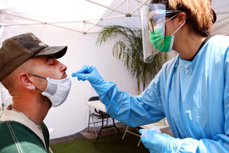 A registered nurse administers a Covid-19 test to Blake Hardy at Sameday Testing on July 14, 2021, in Los Angeles.
