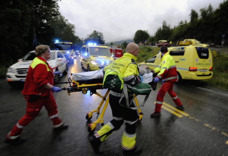 Image: Rescue workers evacuate a wounded person after a shooting on the Norwegian island of Utoya on July 23, 2011.