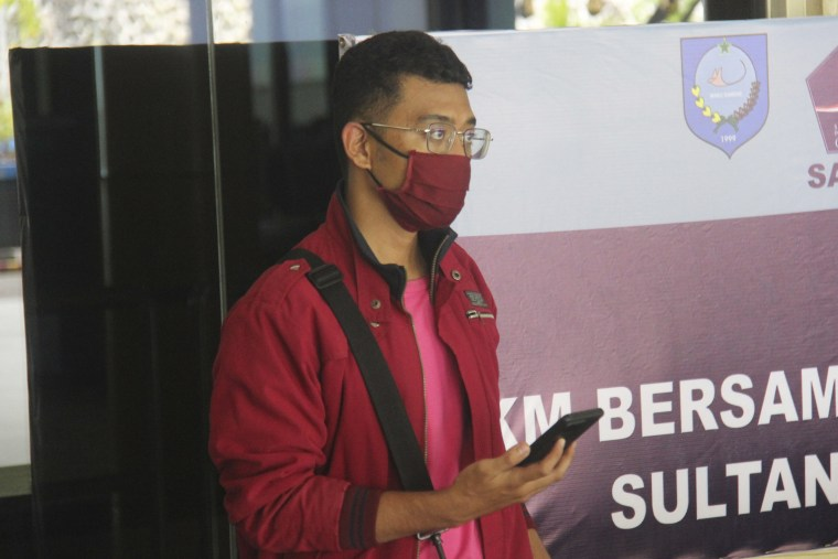 Image: A man who used a fake identity arrives at the Sultan Babullah airport in Ternate, Indonesia